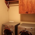 laundry room hardwood single cabinet single wood shelf with single wood hanging kit unit a hanger two units of laundry machines