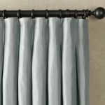 light grey pleat curtain with black hooks