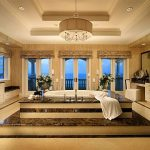 Luxurious Bathroom Design With Exclusive Bathtub In Victorian Style Also Gorgoeus Chandelier With Magnificent Gold Tone With Large Vanities In Tile Flooring