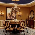 luxurious dining room with gorgeous dark and soft brown color combination with ravhsinig wooden chairs and glossy dining table with crystal chandelier and wonderful rectangular rug for classic house style