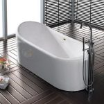 luxurious narrow bathtub unit in white stainless steel bathtub faucet elegant black wood flooring a folding soft towel