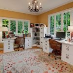 magnificent home office design with alluring orange wall decoration and ravishing ratttab chair completed with white cabinet in flower motif rug