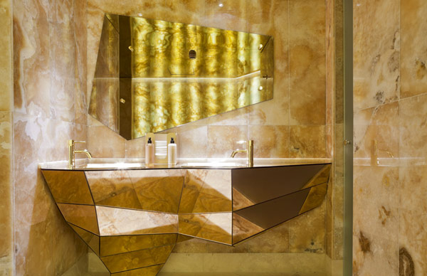 marble tiled wall unique shaped bathroom counter unique shaped mirror eclectic bathroom hotel design unique hotel - Eclectic Hotel 2015