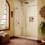metal carving ornament  ornamental plants glass shower with wall-shelves hanging shower faucet simple brown backless chair brown tiles flooring
