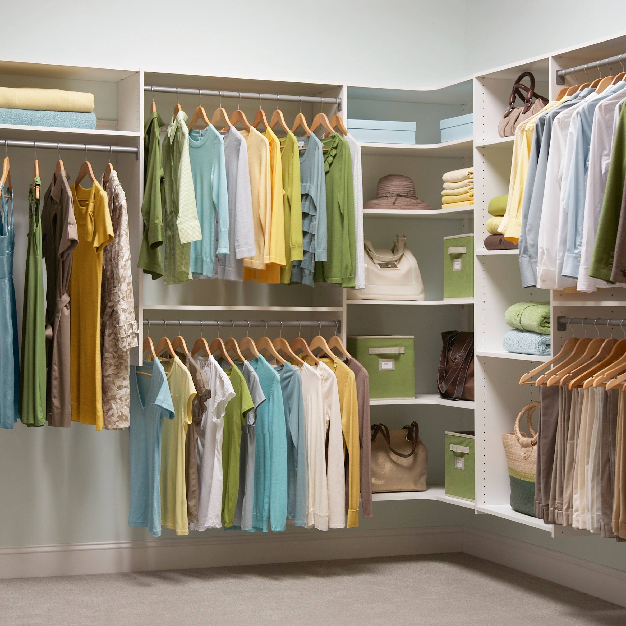Minimalist White Shelves Units With Steel Hanging Rods Sets Hanged Clothes  Piles Of Towels And Blankets