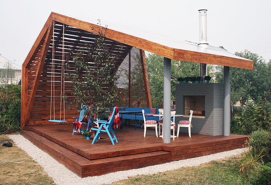 Modern Outdoor Pavilion Construction With Timber Wall System A Pair Of Blue  Chairs A Blue Bench