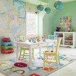 Pastel Green Painted Wall Map Wallpaper Hanged Globes White Painted Table Colorful Chairs White Painted Storage Colorful Luggage Gray Rug With Colorful Aplhabet Pattern Colorful Suitcases Cute Kids' Room