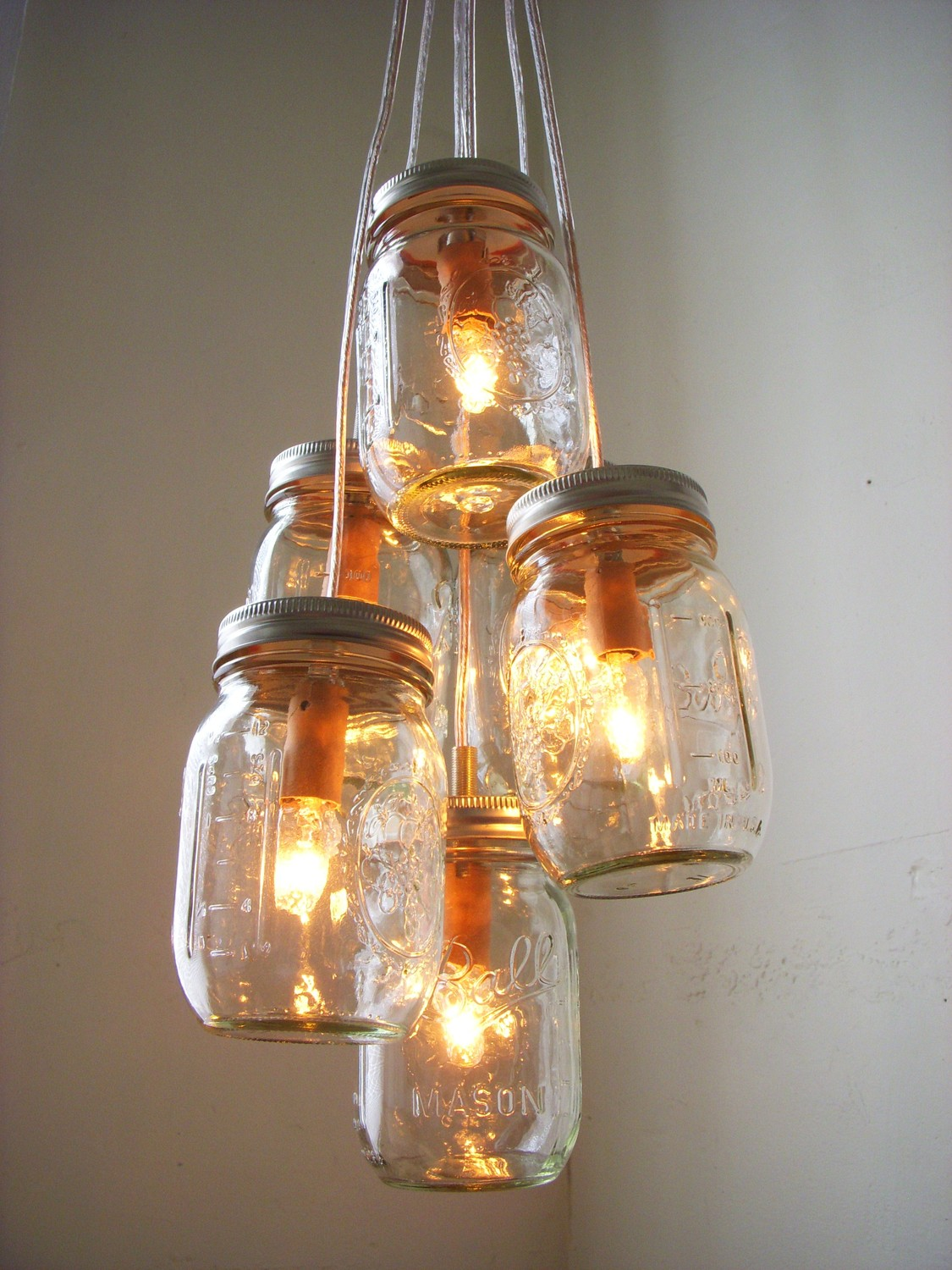 How to create mason jar lighting fixtures homesfeed for Hanging lights made from mason jars