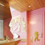 pink painted wall ancient Athens patterned wall decor wooden ceiling unique shaped powder room mirror pink door eclectic room design unique hotel design of the NEW hotel in Greece