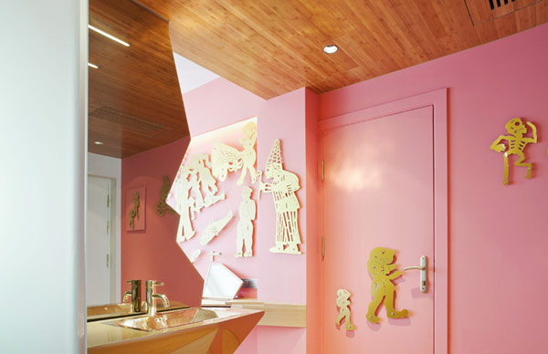 eclectic bathroom hotel design unique hotel pink painted wall ancient athens patterned wall decor wooden ceiling unique shaped powder room mirror pink