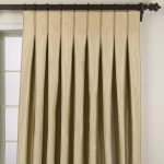 pretty  cream-tone pleat curtains with black stick and hooks