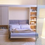 pretty purple folding bed with storage and shelves round white soft rug