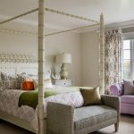 purple sofa white vase white ceiling white wood side tables pale green table lamps with white covers floral printed curtain white chinese fourposter bed white rug white framed window darkwood flooring