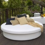 round white daybed for outdoor a pile of brown and black pillows dark wood plaque floors