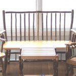 setee bench with wood vertical-strip back small wood plaque table