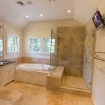 shower no door with a frameless glass platform a large bathtub cream ceramic tiles floor