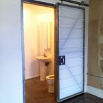slide-wood barn door with strips pattern closet standing sink and faucet