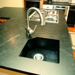soapstone kitchen sink installation with bigger metal faucet  elegant black soapstone-finish countertop modern kitchen stove