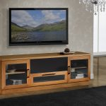 softwood finish TV console with glass door cabinets comfortable black carpet