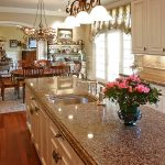 sparkling-look granite countertop with storage and stainless steel sink and faucet beautiful roses ornament triple-arrangement pendant lamps hardwood flooring