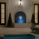 stone block flooring black lantern sconce white wall with cream trim black framed windows blue diagonal tile fountain beautiful black and white tile for edge swimming pool