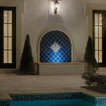 Stone Block Flooring Black Lantern Sconce White Wall With Cream Trim Black Framed Windows Blue Diagonal Tile Fountain Beautiful Black And White Tile For Edge Swimming Pool