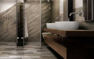 tiles-like- natural wood floor big mirror-wall beautiful rounded sink planted-metal faucet wood counterop for bathroom  vast-box shower area big box toilet area