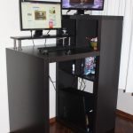 tiny black dek stand for office two sets of flat-screen computers