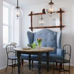 transparent-glass-ball pendant lamps ornamental mirror with wood frame blue-ocean setee with hihger back tiny metal chairs classic round wood tables hard-wood finish floors