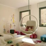 transparent hanging chair with white pillows kids' wall painting foot-print carpet mini colorful round chairs  mini conventional TV accesory