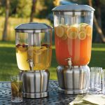 two casual glass beverage gallons with metal stand and spigot in different size