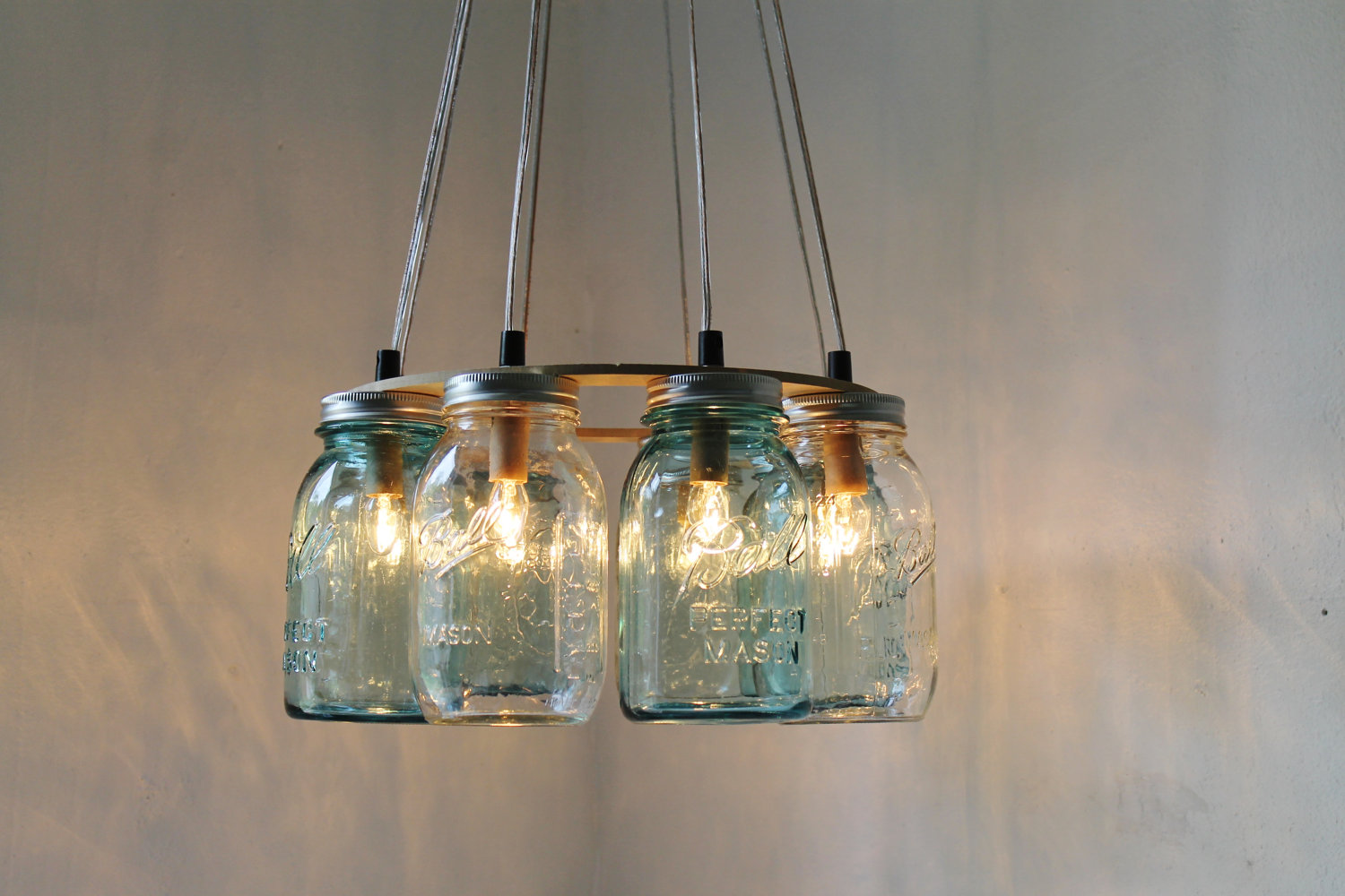 How to create mason jar lighting fixtures homesfeed unique hand made pendant lamp from some mason jars arubaitofo Image collections