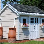 unique shed with sun cell panels two mini windows and  big entrance door two big decorative vases made from clay