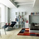 white brick walls style for bedroom unique bed set colorful fury carpet sophisticated book shelving  black comfy reading chair artistic reading lamp big frameless  glass window a pair of wired-metal chairs
