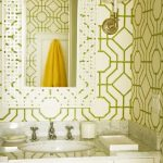 white cabinet with light grey granite counter white undermount sink yellow towel white beautiful patterned mirror frame bamboo patterned green and light yellow wallpaper cream sconce