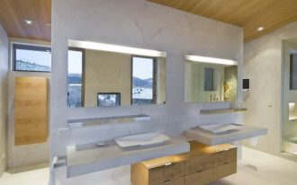 white floor wood ceiling white wall square mirrors with LED lighting iron framed window floating white counters wood cabinet simple low profiled white vessel downlights
