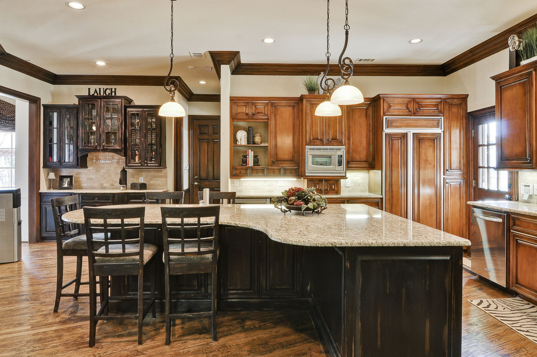 Allow extra room for dining with a large kitchen islands for Kitchen pics