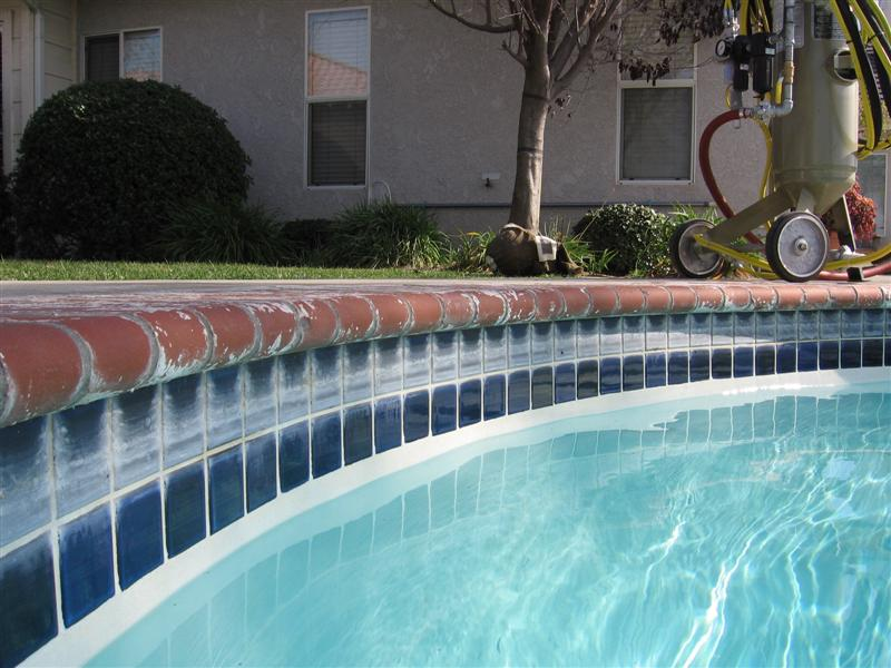 Decorate your swimming pool with attractive tiles homesfeed for Pool design tiles