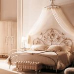 white wardrobe cream console chair white wall white curtain elegant gold canopy bed white bedding set metallic side table white table lamp white mosquito net white floor crown-like canopy frame
