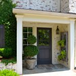 white washed bricked exterior wall gray painted wooden front door procelain front entry floor white painted window frame geometric shape front entry design beautiful front entry