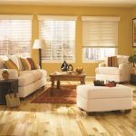 white wood window blinds sweet white living room furniture standing lamp with white cap large black box storage modern fireplace gold-red rug wood-finishing floors