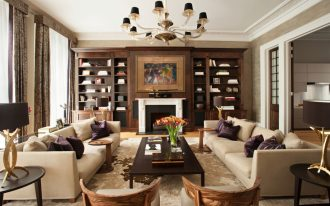 wonderful brown living room with gorgeous large teak wooden cabinet also energizing fireplace with elegant desk lamp in warm rug design