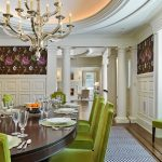wonderful dining room idea with fresh lime chairs and glossy top table for dining feat elegant chandelier also beautiful flower wall paper with stripe rug in laminate flooring