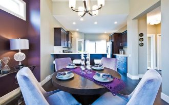 wonderful dining room ideas with cozy fabric chairs and ravishing round table with elegant dark purple wall panel feat smalll kitchen area in laminate flooring