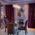 wonderful purple dining room idea with xozy fabric dining chairs also transparent glass top table with wide dark pruple curtain also crystal chandelier in soft granite flooring