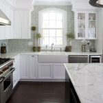 wonderful white kitchen idea with glossy marble countertop with mosaic tile backsplash and wooden white cabinet in hardwooden flooring