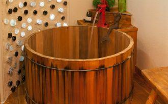 wood Japanese deep tub unique oldish tub's faucet mini ornamental statue green grass ornament green ornamental bottle hardwood floor idea attractive wall installation