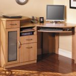 wood files cabinets with shelves a flat screen computer set a family picture telephone set scanner set hardwood flooring