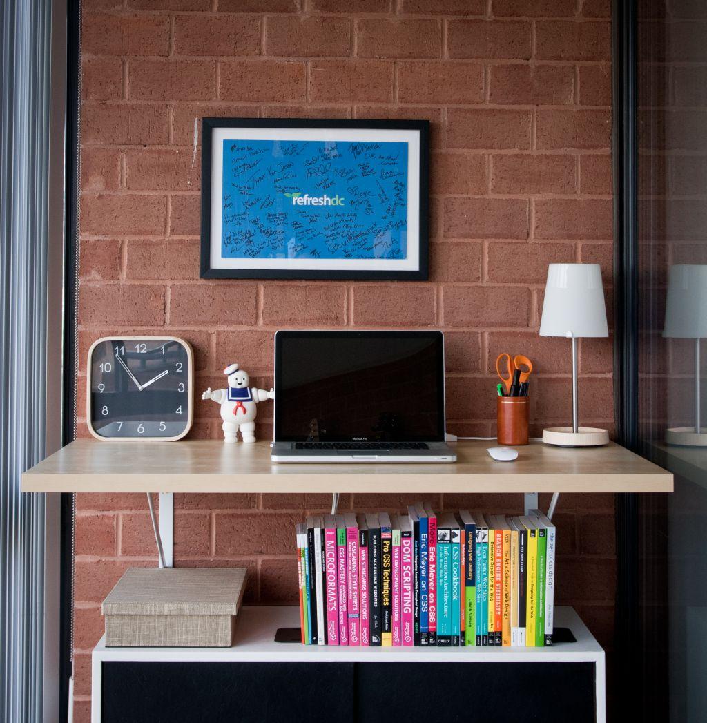 wood finishing platform standing desk brick desk wall clock