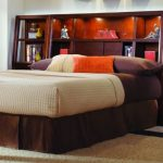 wood headboard with extra large shelves and cabinetry units cozy and thick mattress colorful pillows